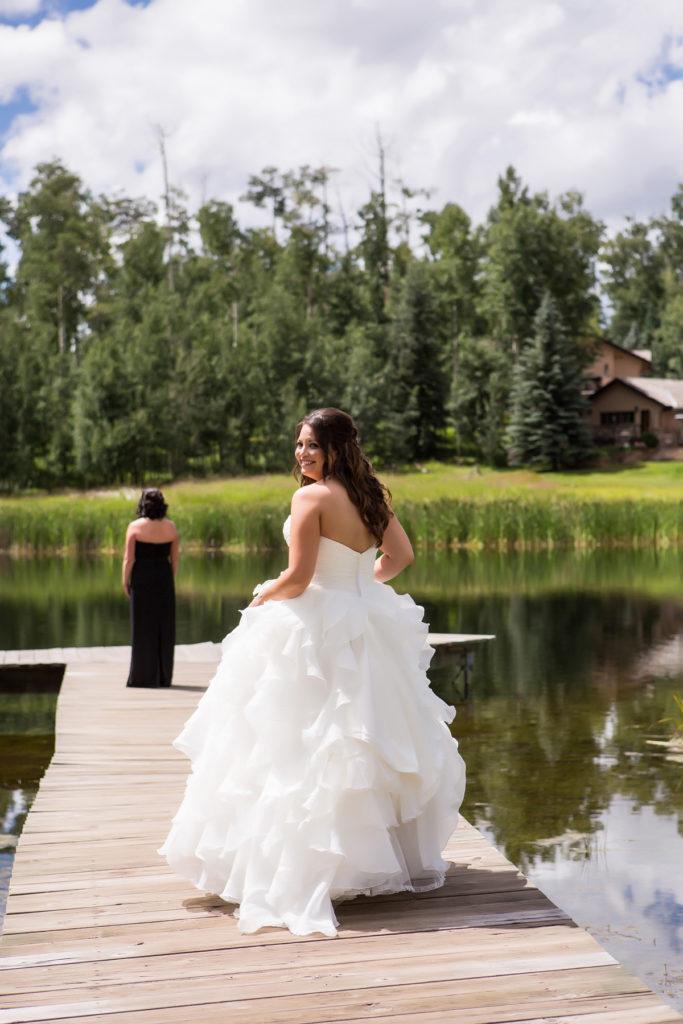 Lesbian telluride wedding first look at elk pond in telluride, colorado.