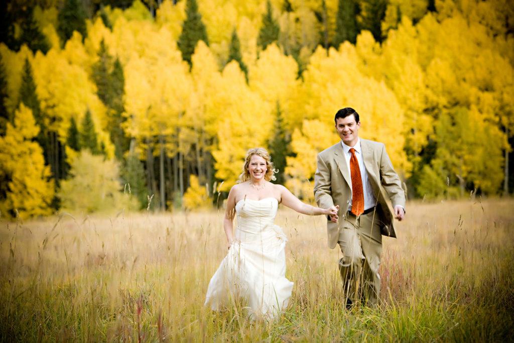 fall Telluride elopement couple walks hand in hand