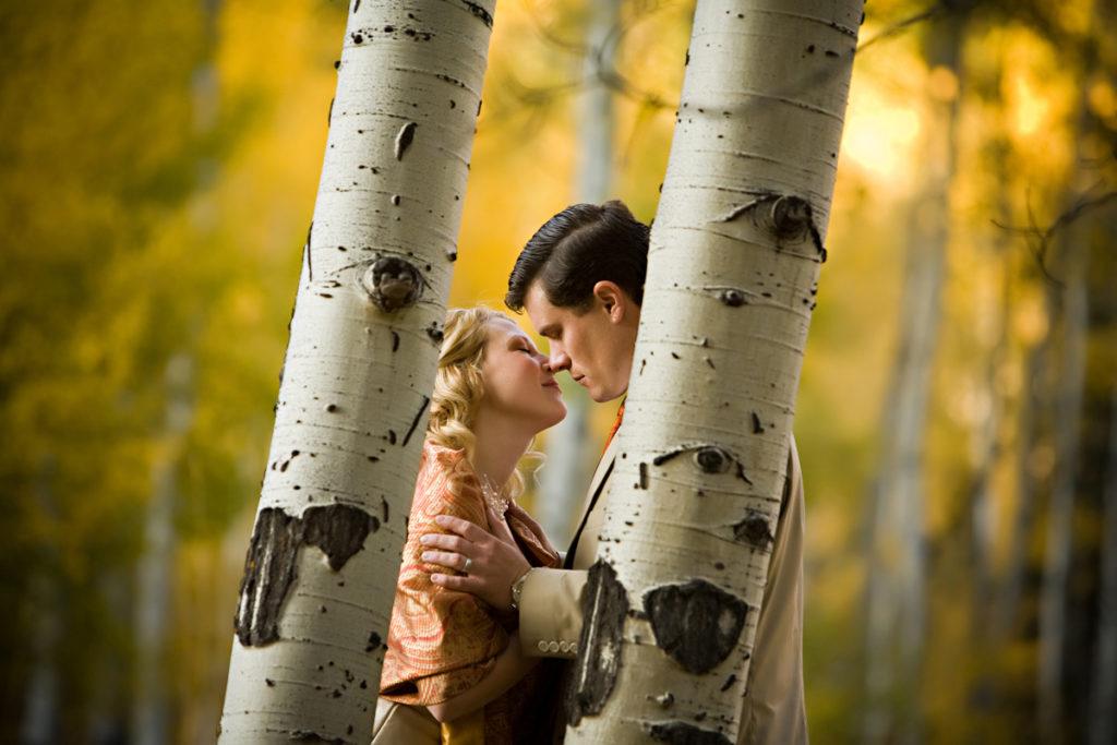 Couple embraces in the fall aspen trees in Telluride, Colorado