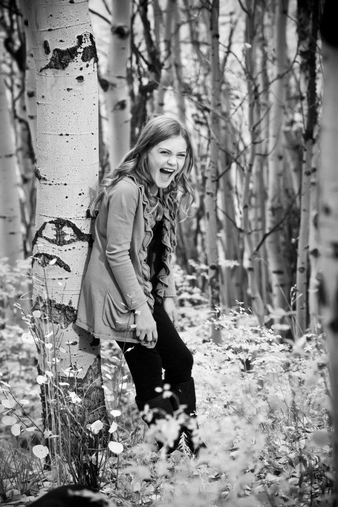 kid in the aspen trees in Telluride Colorado
