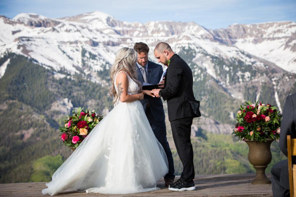 Elopement at San Sophia Overlook in Telluride, Colorado. Exchanging of the rings