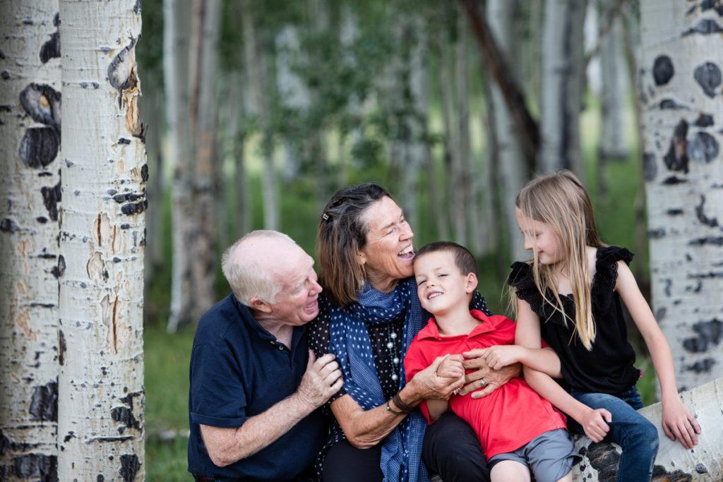 hugging and loving on Grandma and Grandma in the aspen trees of Telluride, CO