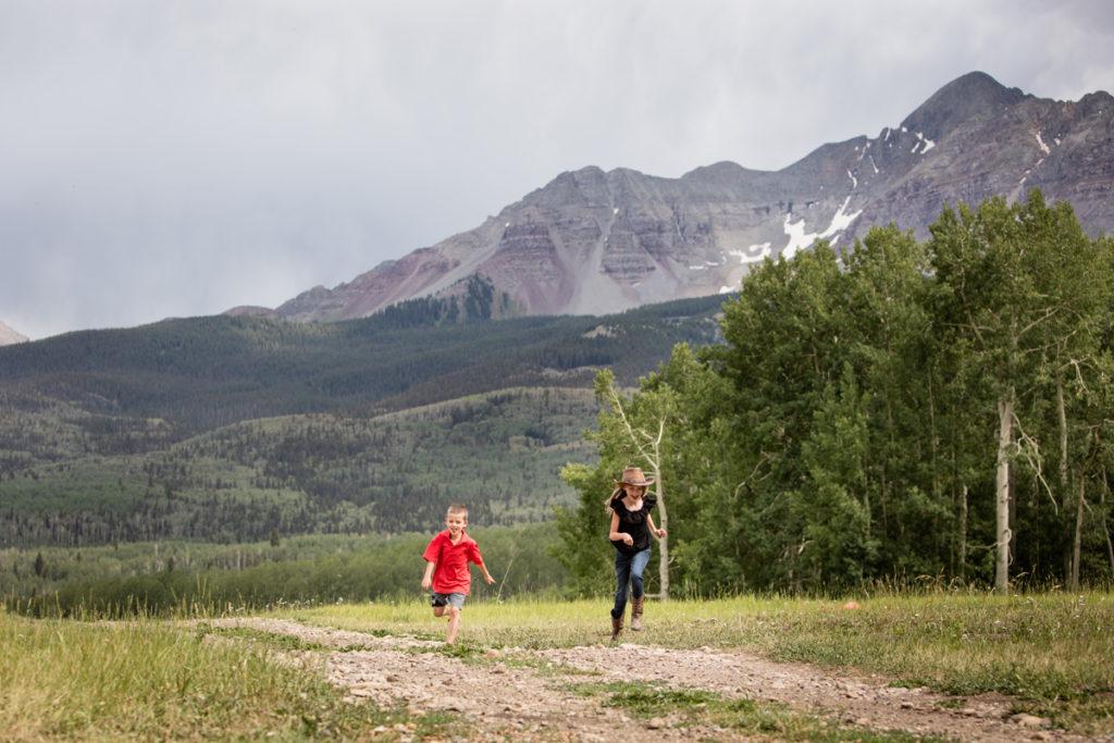 kids running on wilson mesa in Telluride, COO
